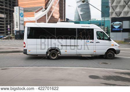 Mercedes-benz Sprinter Speeding On Road. White Minibus Mercedes Sprinter Van In Motion. Moscow, Russ