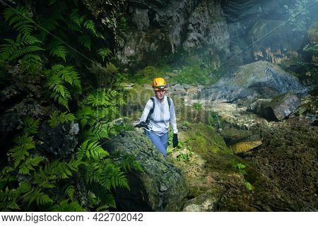 Woman Traveler Explores Beautiful Hang Tien Cave In Phong Nha Ke National Park. Vietnam.