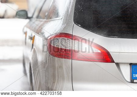 Detail Of Taillight Of A Silver Modern Car Inside Carwash With Soap Dripping.