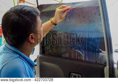 Labuan,malaysia-may 24,2019:process Of Installation Tinting A Car Window With Tinted Foil Or Film By