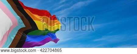 Progress Lgbtq Rainbow Flag Waving In The Wind At Cloudy Sky. Freedom And Love Concept. Pride Month.
