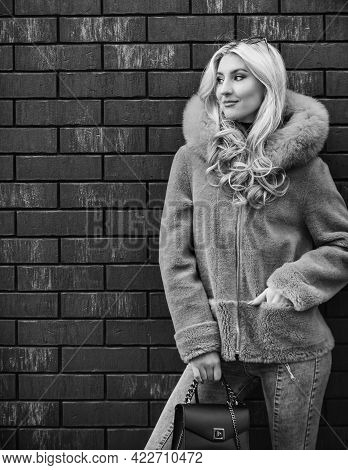 Street Style. Spring Summer Trend. Fashionable Woman In Pink Fur Coat. Cold Season. Autumn Or Winter