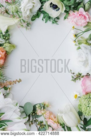 Fresh flowers frame on a white background