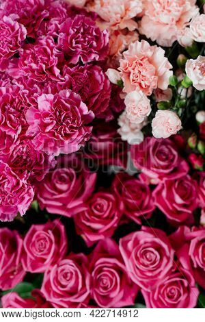 Pink and peach carnations with pink roses in a flower shop
