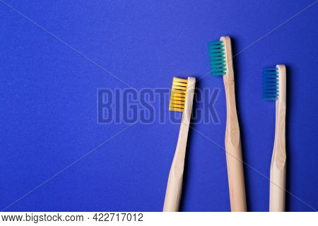Bright Toothbrushes On A Blue Background