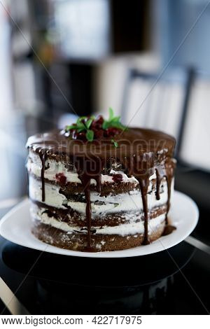 Chocolate Brownie Cake With Cherries And Cream Cheese On A Plate