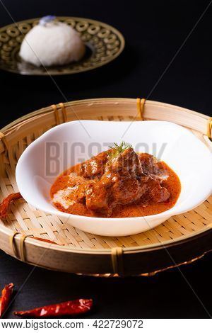 Thai Cuisine Concept Homemade Red Curry Veal Panang And Thai Rice In Black Background With Copy Spac