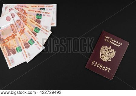 Russian Passport And Russian Currency Close-up Lying On A Black Background