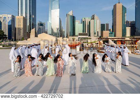 Abu Dhabi, Uae - December 14, 2019: Traditional Emirati Male Al Ayalah Dance At Al Hosn Festival