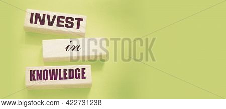 Invest In Knowledge Words Onwooden Blocks. Inspirational Motivational Quote. Investment In Knowledge