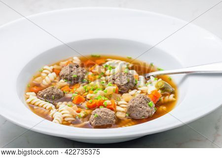 broth with liver dumplings, carrot and pasta