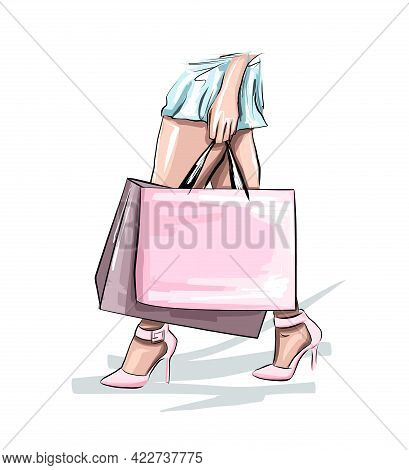 Beautiful Young Woman With Shopping Bags. Fashion Woman In Blue Skirt. Women On The Background Of Th