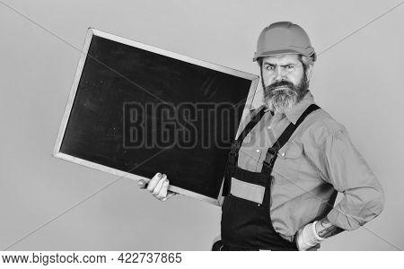 Architect Demonstrating Project. Professional Repairman. Visual Outline. Bearded Man Repairman Build
