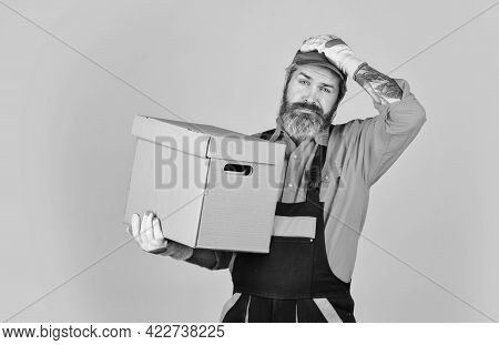 Change Is In The Air. Bearded Loader In Uniform. Cardboard Boxes - Moving To A New House. Purchase O