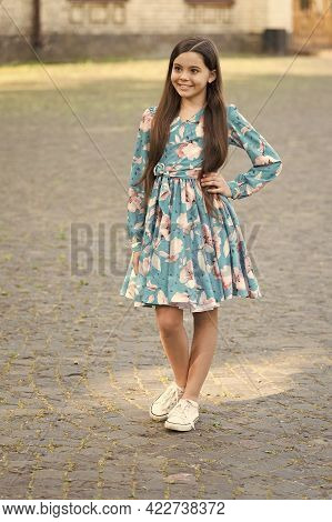 Fashion Inspired By You. Fashion Look Of Little Girl. Happy Child With Long Hair Smile Urban Outdoor