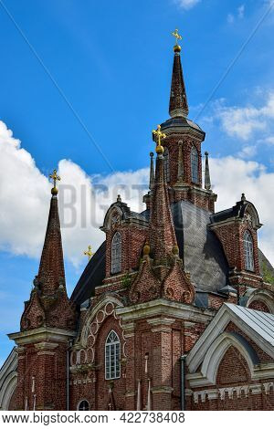 High Spires With Gold Crosses On The Church Of The Icon Of The Mother Of God The Sign. The Village O