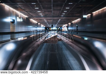 View With A Shallow Depth Of Field Of Two Travelators In A Modern Airport Area With A Selective Focu
