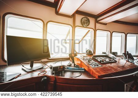 View Of A Cockpit Area Inside Of A Deckhouse Of A Modern Safari Or Cruise Yacht With A Control Panel