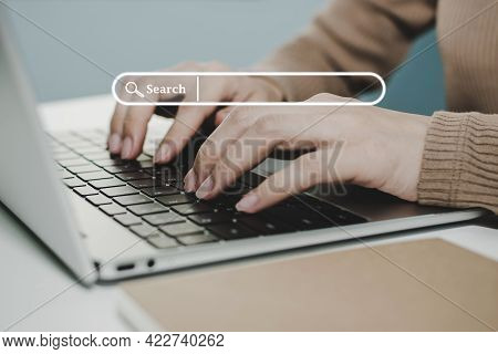 Website. Business Woman Working On Laptop Computer On Desk With Visual Screen Search Button, Searchi