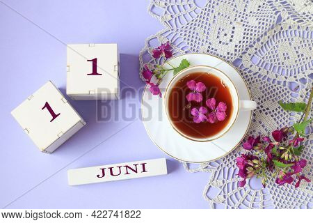 Calendar For June 11: Cubes With The Number 11, The Name Of The Month Of June In English, A Cup Of T