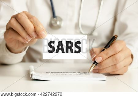 Doctor Holding Card In Hand With Words Sars, Medical Concept. Healthcare Conceptual For Hospital, Cl