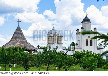 Pasarea Monastery, Orthodox Church Architectural Details. View Of Orthodox Church And Green Churchya