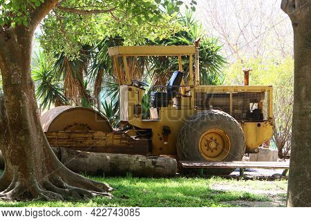 Old Agricultural Machinery Stands In A City Park In Northern Israel