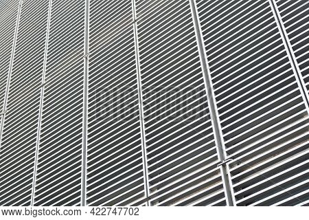 Abstract Architecture. Modern Structure Of Geometric Architecture. Monochrome Latticed Wall