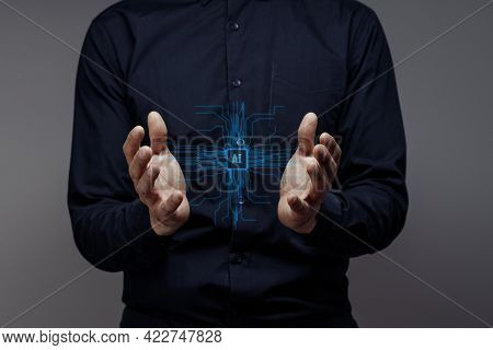 Businessman Holds The Ai. Concept Of Modern Computer Technologies, Data Mining. Hands Touch The Futu