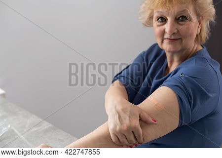 Female Senior Getting An Swine Flu Shot