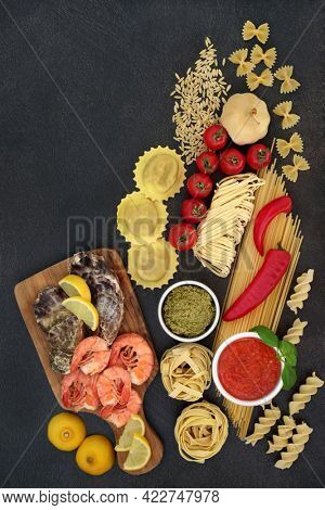 Low cholesterol Mediterranean and Italian food cuisine with pasta assortment, vegetables, fruit, sauces and  seafood. High in anthocyanins, omega 3, protein, antioxidants, lycopene and dietary fibre.