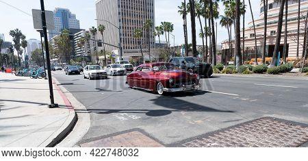 Long Beach, California Usa - April 11, 2021: Red Chevrolet Kustom Retro Car Crossing Road. Luxury