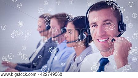 Composition of network of connections with icons over businessman using phone headset in office. global business, connections, data processing and technology concept digitally generated image.