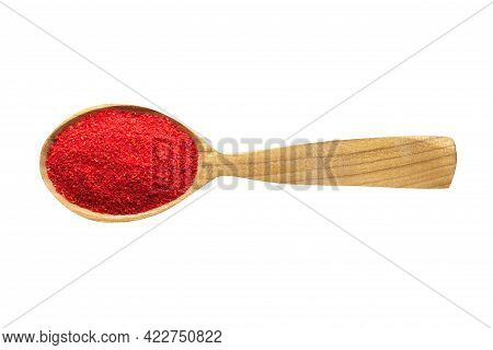 Paprika Powder For Adding To Food. Paprika Spice In Wooden Spoon Isolated On White. Paprika Seasonin