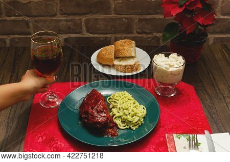 Plate Of Food On Wooden Table. Roasted Ribs Marinated With Barbecue Sauce, Spaghetti And Wine. Perso