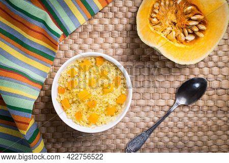 Millet Porridge With Pumpkin Slices On A Wicker Napkin.