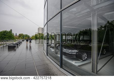 Germany Dresden - August 2015: Car In A Showroom Of The Volkswagen Building, Car Behind Glass. Glaes