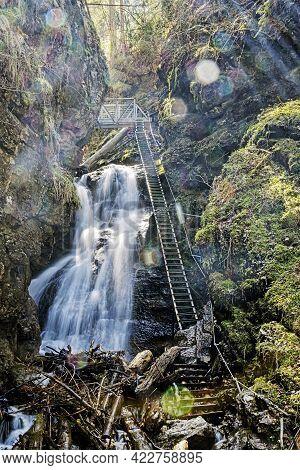 Big Waterfall In Velky Sokol Gorge, Slovak Paradise National Park. Seasonal Natural Scene. Long Time