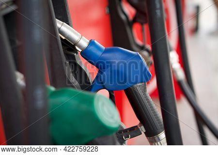 Closeup Blue Gas Pump Nozzle In Gas Station.