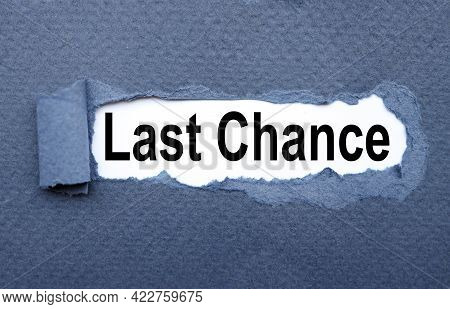Last Chance. Text On Torn Cardboard. Black Letters On White Paper