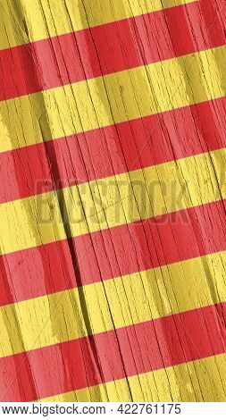 Catalan Flag On Dry Wooden Surface, Cracked With Age. Vertical Background Or Mobile Phone Wallpaper