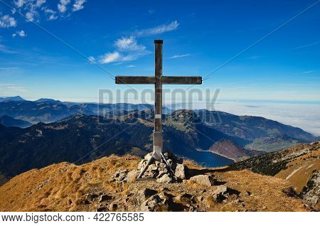 Summit Cross On The Zindlenspitz In Between The Glarus And Schwyzer Mountains. Summit In The Innerth