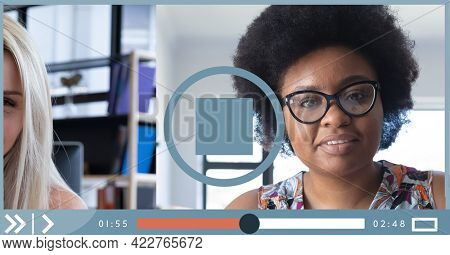 Composition of two businesswomen having video call on video playback interface screen. global business communication technology concept digitally generated image.