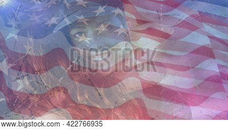 Composition of female soldier embracing daughter over american flag. soldier returning home to family concept digitally generated image.