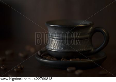 Black Coffee Cup, Coffee Beans On A Wooden Surface. Fragrant Morning Coffee, Invigorating Hot Drink,