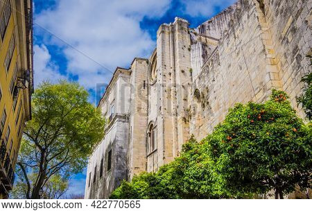 Stone Walls Of The Castle Of St. George, Alfama, Lisbon, Portugal With Citrus Trees