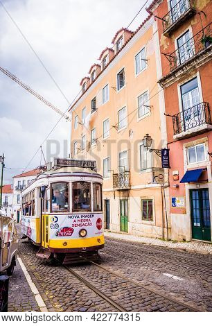 Lisbon, Portugal - March 25, 2017: Popular Tourist Old Yellow Vintage Tram Number 28 On The Street O