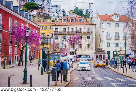 Lisbon, Portugal - March 25, 2017: A Typical Old Yellow Vintage Tram 28 On The Street Of Lisbon, Por