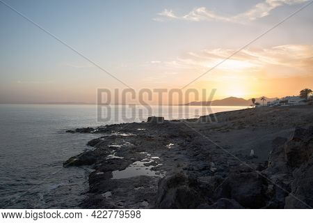 Beautiful Sunset At Lanzarote, With A Traditional White House On The Seashore. Canary Islands, Spain
