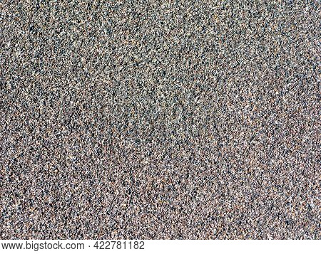 Close-up Of Black Sand From Khalaktyrsky Beach. The Sand Is Dark In Color Because It Is Of Volcanic